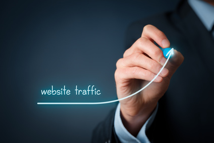 Website traffic improvement concept. Businessman drawing increasing graph with text: website traffic.